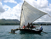 Canoe sailing.